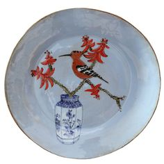 An original ceramic work by Lisa Ringwood entitled: 'Blue Hoopoe and Coral tree branch platter'
