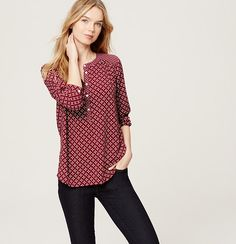 Artful shirring infuses this versatile henley with a sense of fluidity and flow. Round neck. Long sleeves with button roll tabs and cuffs. Henley button placket. Shirred beneath shoulders and back yoke. Shirttail hem.