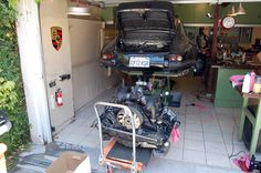 The Garage is a two-car garage in California with some innovative work and storage solutions. Two Car Garage, Dream Garage, Hydraulic Cars, Porsche 911 Targa, Vintage Porsche, Diy Network, Garage Shop, Yellow Painting, Metal Fabrication