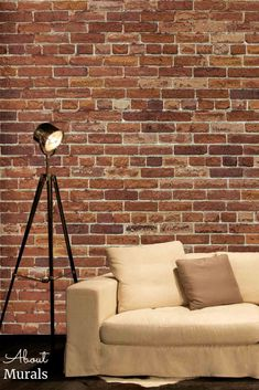 Not Just Another Brick on the Wall Mural is a realistic red brick wallpaper that adds tons of texture to walls. It creates a cozy feeling living room, bedroom or home office. The removable wallpaper is easy to hang and eco-friendly. Faux Brick Wallpaper, Brick Design, Red Bricks, Tripod Lamp, Wall Murals, Eco Friendly, Walls, Cozy, Texture