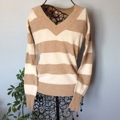 "Mossimo Long sleeve pullover sweater beige. Long sleeve sweater. V neck, lightweight.  Beige and off white color. Gently worn condition. Length is 21 1/2"". Across front is 15"". Width of hem is 22"". Mossimo Supply Co. Sweaters V-Necks"