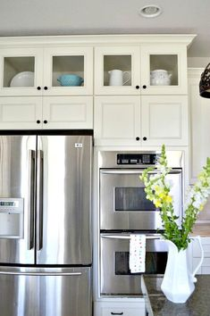 A Wall Built In Microwave Cabinet Keeps Counter Clear And