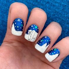 """Bianka I Nailart & Swatches en Instagram: """"Hello! 💙 Polar bear for #glamnailschallengejan ❄️🐻❄️ Here is my design for the theme! 🤗 I painted my nails with a dark blue metallic nail…"""""""