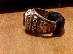 "Wearing ""his"" class ring..."