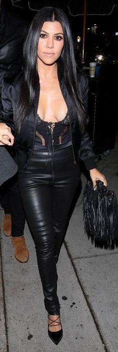 Who made  Kourtney Kardashian's black leather fringe handbag, satin bomber jacket, and lace up pumps?