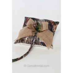 Camo and Burlap Pillow Shown in Mossy Oak New Breakup and Burlap. Available in all camo patterns and burlap. Made in the USA.