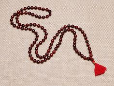 Rosewood represents Ganesha, the remover of obstacles. It offers protection to the wearer by keeping out negative energy and strengthening the aura. Rosewood also has multiple health benefits. It helps fight viruses and regenerate cells, is good for jet lag and skin inflammations, and aids in relaxation without making you drowsy.  http://atmasofferings.com/product/rosewood/