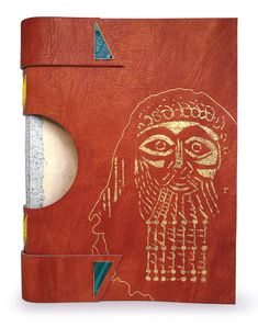 The Legend of Gilgamesh bound by Mel Jefferson. Crossed-structure binding, laminated native-dyed & beige Harmatan goatskin. Onlays of feathered gilded goatskin & inkjet-printed calfskin. Green 'lacunose' buttons w/ gold-plated brass frames. Single-stage sewing w/ endbands. Head decorated w/ acrylic & flecks of gold & silver leaf. Front & rear designs inspired by Parry's woodcuts. Interior represents river Euphrates & ancient city of Uruk. Colors denote heat, sun, desert, & fertile land.