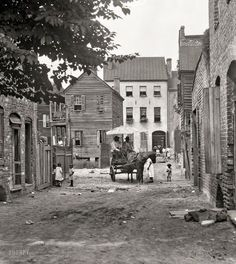 "Charleston, South Carolina, circa 1920. ""Street scene with horse and wagon."" 4x5 inch nitrate negative by Arnold Genthe."