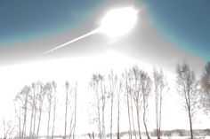 A meteoroid fell to Earth on February 15, streaking some 20 to 30 kilometers above the city of Chelyabinsk, Russia at 9:20am local time. Initially traveling at about 20 kilometers per second, its explosive deceleration after impact with the lower atmosphere created a flash brighter than the Sun. This picture of the brilliant bolide (and others of its persistent trail) was captured by photographer Marat Ametvaleev, surprised during his morning sunrise session creating panoramic images.