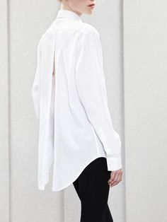 You can't go wrong with a beautiful white shirt paired with slim-fitting black trousers.