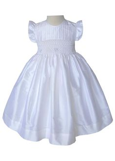 Our new off white silk dress for baby girls, toddles and older girls is gorgeous! Perfect for a Flower Girl, we like to call this one Ivey, it is fully lined and is smocked by hand. The hand smocking