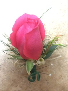 Pink rose boutonnière with wax flower, tree fern, seeded eucalyptus leaves, and a twine accent loop by #SunshineFlorist
