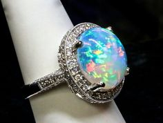 Tiffany Style opal and diamond ring. Natural Solid by AmyKJewels.