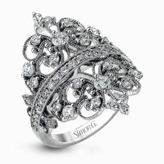 How gorgeous is this regal, dual crown ring by Simon G. featuring glimmering round cut white diamonds? Very!