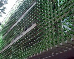 In quiet street in Mexico City there is an amazing green building covered with a façade comprised of more than 7,723 hand-blown glass spheres called the Hesiodo and created by Hierve-Diseñería