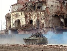 The Chechen Wars Cast a Long Shadow — War Is Boring — Russian troops pass destroyed buildings in Grozny on March Anatoly Maltsev/AP photo. 40k Terrain, Armored Fighting Vehicle, Military Art, Military Uniforms, War Photography, Battle Tank, Long Shadow, Modern Warfare, War Machine