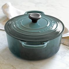 Le Creuset  Cast-Iron Round Dutch Oven... Oh how I adore thee..... but HOLY CRAP BATMAN... that price!