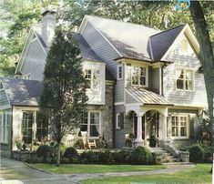 Combination of stone, shakes and siding with cream trim.