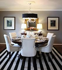 Slip covers for our chairs in linen, our dark wood oval table, stripped rug and our puka shell chandelier...?