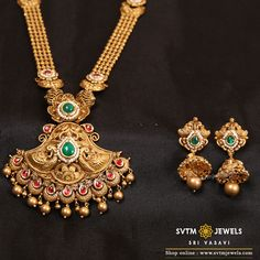 Adorn yourself with this gold long necklace with it's matching earring beautified by mayur design distinct on both sides of pendant studded with Bajiira Stones and hanging south sea pearls. Gold Mangalsutra Designs, Gold Earrings Designs, Necklace Designs, Gold Set Design, Gold Jhumka Earrings, Gold Jewelry, Jewellery, Necklace Set, Gold Necklace
