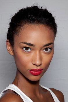 Perfect skin, bright eyes and red lips