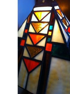 this is a stained glass lamp done in the arts andcrafts design style. it is 16 inches tall. pick up only please. thank you.