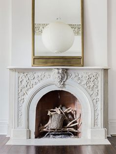 Vaulted ceilings, ornate fireplace,, brass lineal mirror, paper lamp. Nelson Hancock photography