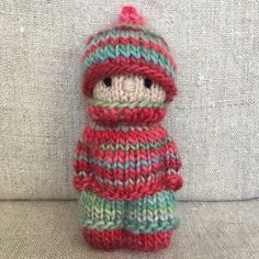 This kid is wearing an outfit knitted from two skeins of variegated Fleece Artist yarn I bought years ago. I had fun seeing the colours… Knitted Doll Patterns, Knitted Dolls, Crochet Toys, Free Crochet, Knitting Patterns, Crochet Birds, Crochet Bear, Crochet Animals, Ideas