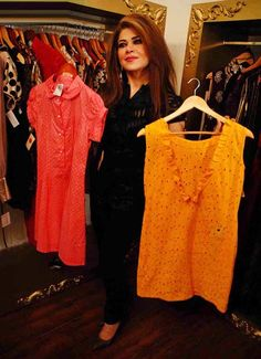 ISLAMABAD: May04 – Renowned actress Mishi Khan showing the dresses during the Red Carpet Launch Event in Islamabad.