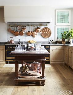 Cérused wood cabinetry inside a cozy kitchen