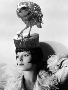 Louise Brooks, wearing a taxidermy owl hat.