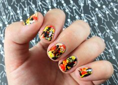 Halloween splatter nail art! I was inspired by Halloween candy and i love how this turned out! Click over to the blog for full details.