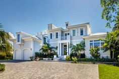 A larger-than-life beach house makes for an idyllic oceanfront retreat. The luxurious home has a sleek, modern style throughout the interior, is full of natural light and features an open floor plan. Numerous decks make indoor/outdoor living a breeze.