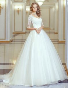 Lace Embroidered Bodice Illusion Neck High Low Ball Gown Tulle Wedding Dress with Long Lace Sleeves Fabric: lace,TulleSilhouette:Ball GownHemline/High LowTrend