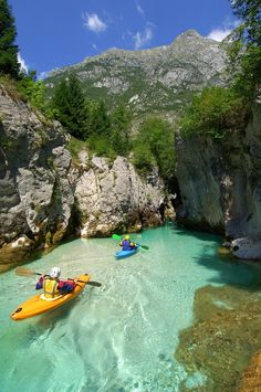 Kayakers making their way through the glacial waters in Slovenia. I don't care where it is, I really want to kayak through clear waters, like this, someday.