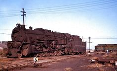 Pennsylvania Railroad Class with a Pennsy sharknose unit crossing the diamond behind in Columbus, Ohio on November Electric Locomotive, Steam Locomotive, New York Central Railroad, Railroad Companies, Pennsylvania Railroad, Old Trains, Train Engines, Steam Engine, Train Tracks
