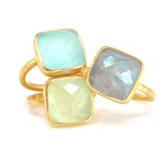 """This stunning ring features a large square aqua chalcedony stone in a modern cushion cut. Framed in a brushed finish bezel. Metal: 14kt gold vermeil Gem: 1/2"""" x 1/2"""" chalcedony Band: 2mm square band /"""
