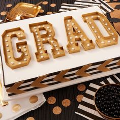 This bold and classy GRAD Marquee Sheet Cake has all the pop and circumstance you're looking for in a celebratory dessert! Striking marquee letters give this cake a neat 3D look, and this cake is great for serving a crowd of hungry graduates!