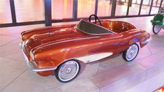 This restored 1958 Corvette Stingray pedal car Motorized Big Wheel, Car Jokes, Pontiac Bonneville, Alfa Romeo Cars, Chip Foose, Power Cars, Vespa Scooters, Pedal Cars, Toy Trucks