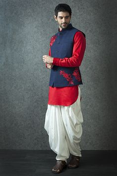 Groom Wear - Red Kurta with Nehru Jacket | WedMeGood | Red Kurta with White Dhoti Pants and a Navy Blue Nehru Jacket with Red Threadwork Outfit by: Benzer for Men For more Groom Wear ideas, visit www.wedmegood.com #wedmegood #indianwedding #nehru #jacket