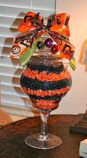 With college color mnm's and a nice grad bow on top could be a cute centerpiece