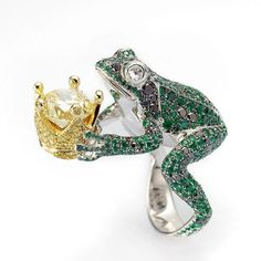 """ryantee82:  From Chopard's Animal World Collection. """"The Frog with Crown ring is both an amusing nod to fairy tales and a very detailed figure. Mounted on a ring of white gold, a frog of emeralds and black diamonds seems ready to jump out and offer up its tiny crown of yellow gold set with brilliants, amongst which is a yellow diamond."""""""
