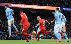 Liverpool's Slovakian defender Martin Skrtel prepares to shoot to score their fourth goal of the English Premier League football match between...