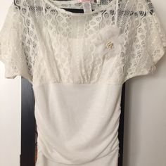Super pretty white top! Really pretty lace top, super flattering! Has a built in cami under. Tops Blouses