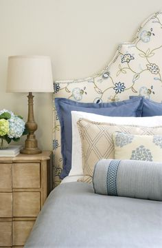 Jaclyn Smith Home Vol. III fabrics and trimmings (Indigo – Dove Gray): Headboard: 02609 – Indigo; Euro Shams: 02636 – French Blue; King Shams: 02615 – Chambray; Throw pillow: 02617 – Chambray and 02919 – Chambray (trim); Bolster pillow: 02622 – Indigo and 02924 – Denim (trim); Coverlet: 02636 – Cornflower.