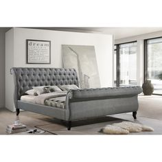 Chic and stylish, the Nottingham grey upholstered sleigh bed features a curvy silhouette, elegant tufting, and superior craftsmanship. Its classic design makes this piece a glamorous highlight of any bedroom.
