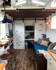 Clean modern farm house. Who's diggin' those dualing sliding barn doors?