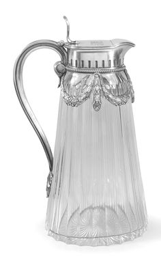 A Fabergé silver-mounted cut glass decanter, Moscow, 1908-1917, of tapering oval section form with fluted sides, the collar mount with a beaded border suspending laurel garlands, the lid engraved with initials ICM, reeded ribbon-tied handle.