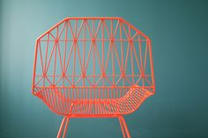 Mimicking a macrame pattern in its orange wire design, the Farmhouse Chair ($500) is a sturdy, comfortable chair, whose backrest was actually inspired by the architecture of old Amish barns.
